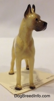 A tan with black Great Dane figurine.