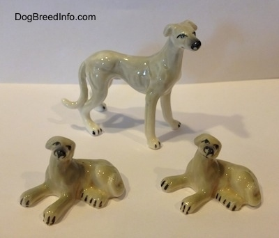 Vintage miniature bone China adult Greyhound with two puppies dog figurine family trio.