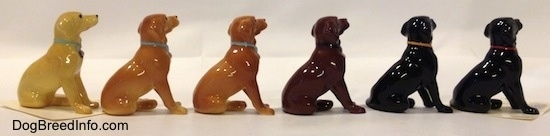 The right side of a line-up of Labrador Retrievers figurines and their different color variations. The figurines are glossy.