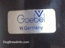 Close up - The underside of a black Labrador Retriever figurine that has a Goebel W. Germany sticker on it.