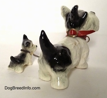 Vintage Goebel figurine set of an adult Miniature Schnauzer chained to its puppy