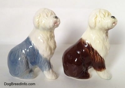 The right side of two porcelain Old English Sheepdog figurines that are in a sitting position. The figures have great hair details.