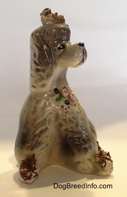 Vintage ceramic spaghetti Poodle figurine from the 1940s to 1950s. Front view.