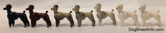 The left side of a Poodle standing figurine. There are seven different color vations. Each figurine has long legs.