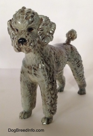 Vintage Standard Poodle dog figurine from West Germany by Goebel. Front view.