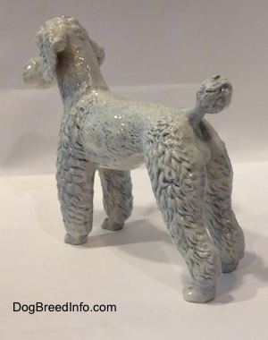 White with a blue tint vintage West Germany porcelain Standard Poodle dog figurine by Goebel. Back-side view