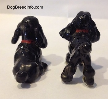Little vintage bone china Poodle couple. Back view.