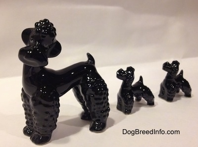 Vintage Goebel porcelain Poodle family, adult and two puppies from West Germany.