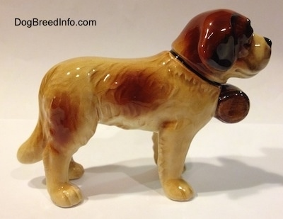 The right side of a figurine of a Saint Bernard porcelain figurine. The figurines ears are hard to differentiate from the head.