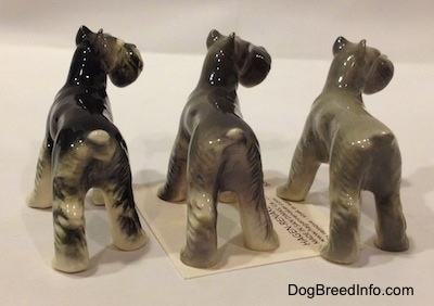 The back of a three color variations of a figurine of a Miniature Schnauzer. The figurines are glossy.