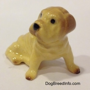 Vintage miniature Hagen Renaker Shar-Pei dog figurine. Front-side view.