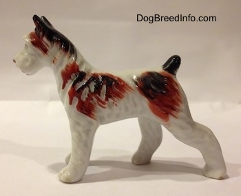 Occupied Japan vintage Standard Schnauzer porcelain figurine, made between 1945 and 1952. Side view.