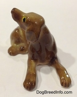 Vintage miniature bone china Vizsla dog. Front view.